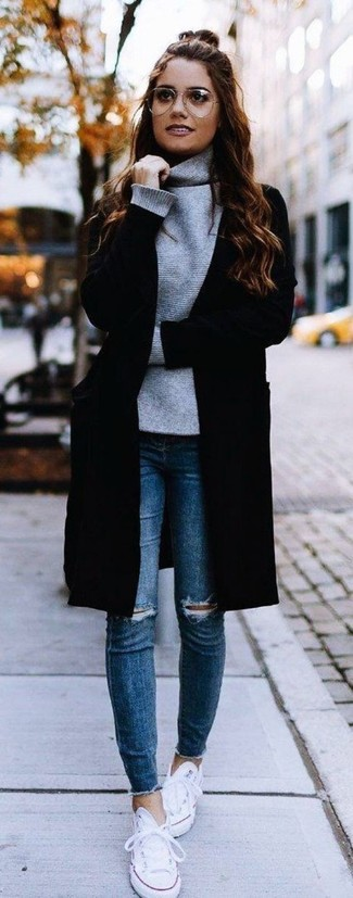 How to wear: white canvas low top sneakers, blue ripped skinny jeans, grey turtleneck, black coat