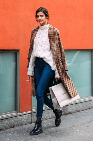 How to wear: black embellished leather chelsea boots, blue skinny jeans, white cable sweater, brown check coat