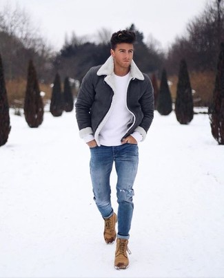 How to wear: tan nubuck casual boots, blue ripped skinny jeans, white crew-neck sweater, black and white shearling jacket