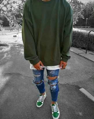 How to wear: green low top sneakers, blue ripped skinny jeans, white crew-neck t-shirt, dark green sweatshirt
