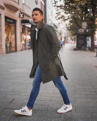 How to wear: white and navy low top sneakers, blue skinny jeans, white polo, olive trenchcoat