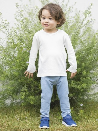 How to Wear a White Long Sleeve T-Shirt For Boys: Dress your little guy in a white long sleeve t-shirt and light blue sweatpants for a fun day in the park. This look is complemented perfectly with blue sneakers.