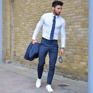 How to wear: blue suit, white dress shirt, white plimsolls, blue polka dot tie