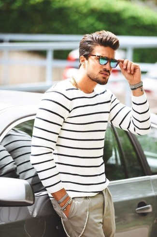 How to wear: blue sunglasses, beige chinos, white and navy horizontal striped crew-neck sweater