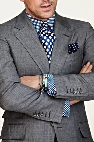 How to wear: navy and white polka dot pocket square, blue polka dot silk tie, blue polka dot dress shirt, grey blazer