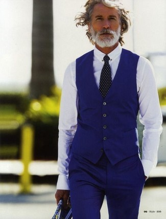 Aiden Shaw wearing Blue Waistcoat, White Dress Shirt, Blue Dress Pants, Black and White Polka Dot Tie