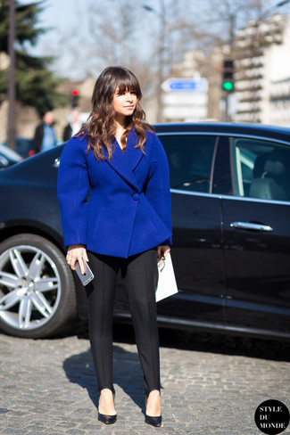 Miroslava Duma wearing Blue Wool Blazer, Black Dress Pants, Black Leather Pumps