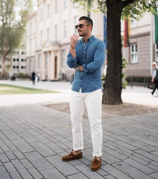 How to wear: black sunglasses, brown suede boat shoes, white chinos, blue chambray long sleeve shirt