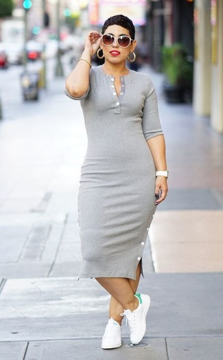 How to wear: grey bodycon dress, white leather low top sneakers, white sunglasses, gold bracelet