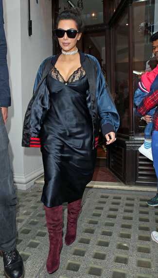 How to wear: black satin bomber jacket, black lace cami dress, burgundy suede over the knee boots, black sunglasses