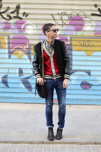 How to wear: black bomber jacket, red cardigan, grey geometric henley shirt, blue jeans