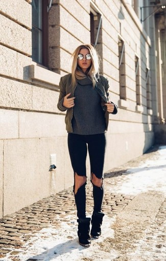 How to wear: olive bomber jacket, charcoal cowl-neck sweater, black ripped skinny jeans, black suede wedge sneakers