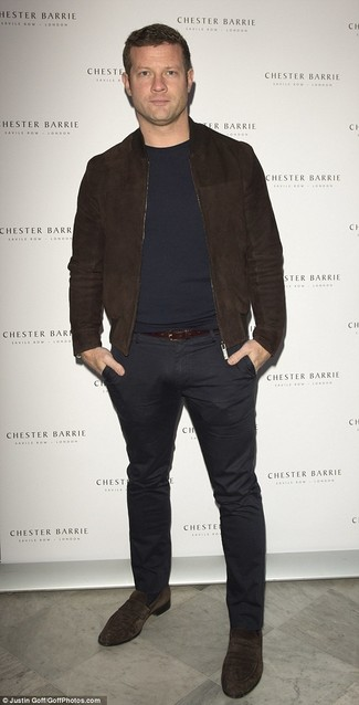 Dermot O'Leary wearing Dark Brown Suede Bomber Jacket, Navy Crew-neck Sweater, Black Chinos, Dark Brown Suede Loafers
