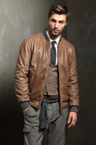 How to wear: brown leather bomber jacket, charcoal crew-neck sweater, brown wool waistcoat, white dress shirt
