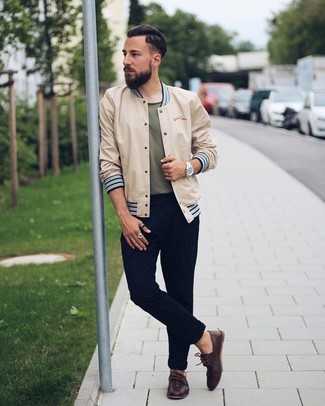 How to wear: beige bomber jacket, olive crew-neck t-shirt, black chinos, dark brown leather boat shoes