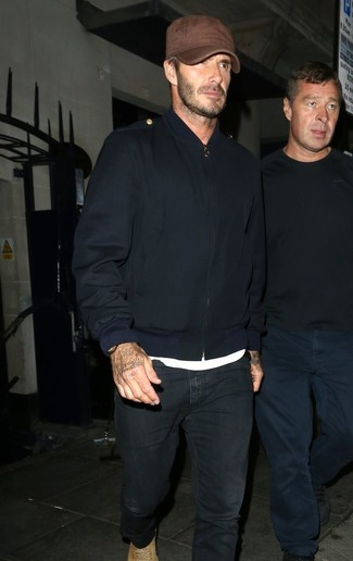 David Beckham wearing Navy Bomber Jacket, White Crew-neck T-shirt, Black Jeans, Tan Suede Casual Boots
