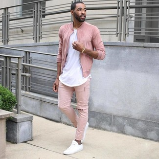 How to wear: pink bomber jacket, white crew-neck t-shirt, pink jeans, white low top sneakers