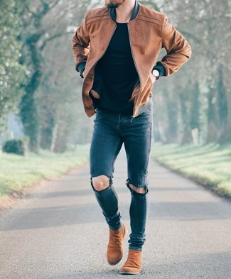 How to wear: brown leather bomber jacket, black crew-neck t-shirt, navy ripped skinny jeans, brown suede chelsea boots