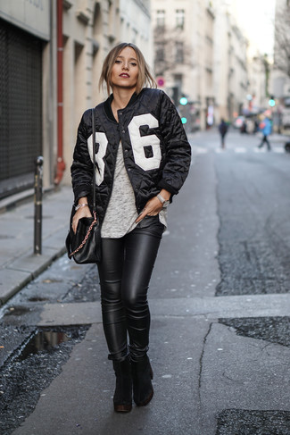 How to wear: black and white print bomber jacket, grey crew-neck t-shirt, black leather skinny jeans, black chunky suede ankle boots
