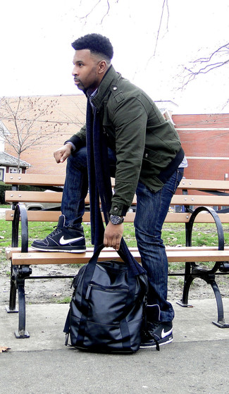 How to wear: dark green bomber jacket, navy and white gingham long sleeve shirt, navy jeans, black high top sneakers
