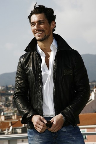 David Gandy wearing Black Leather Bomber Jacket, White Long Sleeve Shirt, Blue Jeans, Dark Brown Sunglasses