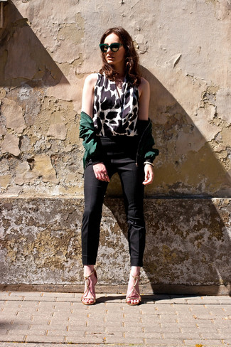 A dark green bomber jacket and dark green sunglasses will convey a carefree, cool-girl vibe. Add gold leather heeled sandals to your getup for an instant style upgrade. We love that this look is great come fall.