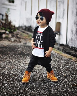 How to wear: black bomber jacket, white and black t-shirt, black sweatpants, tan boots