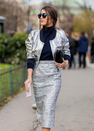 How to wear: silver bomber jacket, navy turtleneck, silver midi skirt, black leather satchel bag