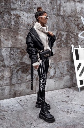 How to wear: black leather bomber jacket, white knit wool turtleneck, black leather skinny pants, black chunky leather lace-up flat boots
