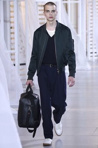 How to wear: black bomber jacket, navy v-neck sweater, white crew-neck t-shirt, navy dress pants