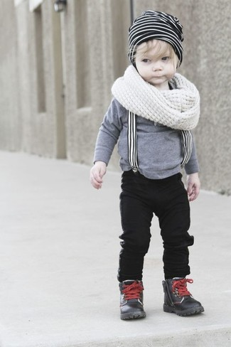 Boys' Looks & Outfits: What To Wear In 2020: Suggest that your little man dress in a grey long sleeve t-shirt and black jeans for a fun day in the park. This getup is complemented really well with black leather boots.