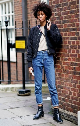 How to wear: black leather ankle boots, blue boyfriend jeans, beige crew-neck sweater, black bomber jacket