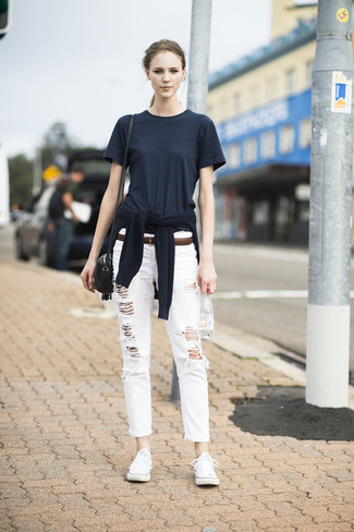How to wear: white low top sneakers, white ripped boyfriend jeans, black crew-neck t-shirt, black crew-neck sweater