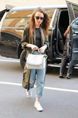 How to wear: white low top sneakers, light blue ripped boyfriend jeans, black crew-neck t-shirt, olive duster coat