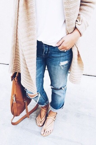 How to wear: tan leather thong sandals, blue ripped boyfriend jeans, white crew-neck t-shirt, tan knit open cardigan