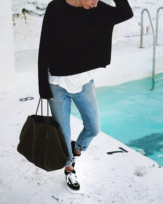 How to wear: black and white canvas low top sneakers, light blue boyfriend jeans, white crew-neck t-shirt, black oversized sweater