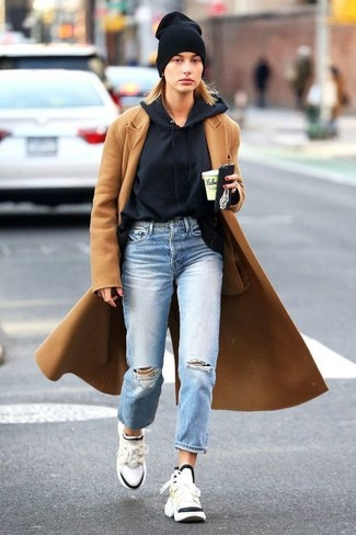 How to wear: white athletic shoes, light blue ripped boyfriend jeans, black hoodie, camel coat