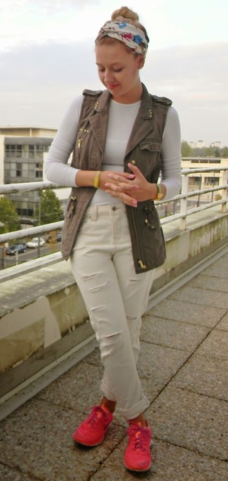 How to wear: hot pink low top sneakers, white ripped boyfriend jeans, white long sleeve t-shirt, charcoal denim vest