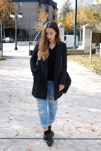 How to wear: black leather platform loafers, light blue ripped boyfriend jeans, black fluffy v-neck sweater, charcoal coat
