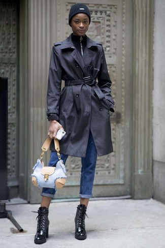 How to wear: black leather lace-up ankle boots, blue boyfriend jeans, black zip neck sweater, black trenchcoat