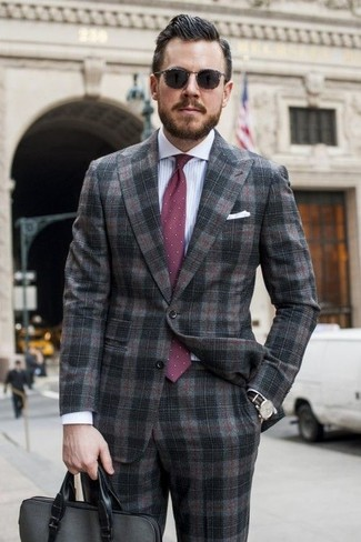How to wear: burgundy polka dot tie, charcoal leather briefcase, white and blue vertical striped dress shirt, charcoal plaid suit