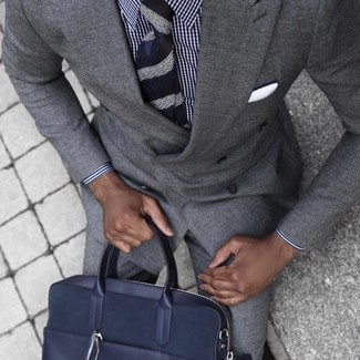 How to wear: navy horizontal striped tie, navy leather briefcase, white and navy gingham dress shirt, grey suit
