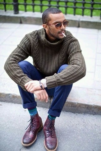 How to wear: brown leopard sunglasses, burgundy leather brogue boots, navy chinos, olive knit turtleneck