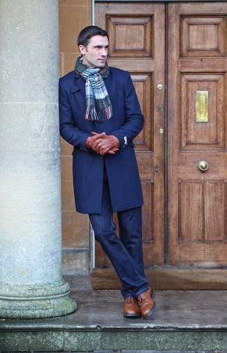 How to wear: blue plaid scarf, brown leather brogue boots, navy jeans, navy overcoat