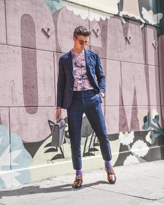 How to wear: grey leather briefcase, tobacco leather brogues, pink floral crew-neck t-shirt, navy check suit
