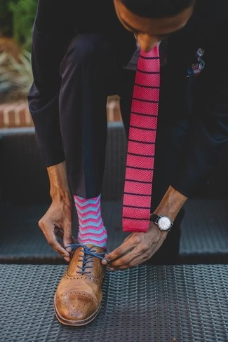 How to wear: hot pink knit tie, brown leather brogues, light blue dress shirt, black suit