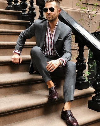 How to wear: black sunglasses, burgundy leather brogues, burgundy vertical striped dress shirt, charcoal suit