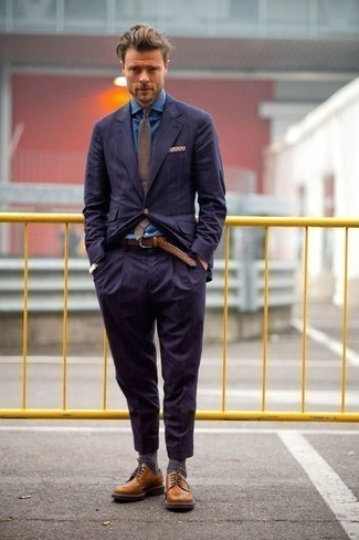 How to Wear a Blue Dress Shirt For Men: This is definitive proof that a blue dress shirt and a navy vertical striped suit are amazing when married together in a sophisticated look for today's gentleman. To infuse a dose of stylish effortlessness into your outfit, finish with a pair of tobacco leather brogues.