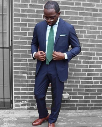 How To Wear a Suit With Brogues: This combination of a suit and a light blue vertical striped dress shirt is a goofproof option when you need to look seriously dapper and classy. Amp up this ensemble by rocking a pair of brogues.