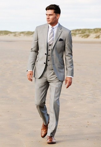How to wear: grey vertical striped tie, brown leather brogues, white dress shirt, grey three piece suit